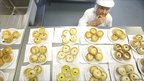 Judge Robert Ross tastes a pie as judging takes place in the World Scotch Pie Championship (Pictures by Jeff J Mitchell/Getty Images)