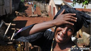 A woman mourns a relative killed in a suburb of Conakry