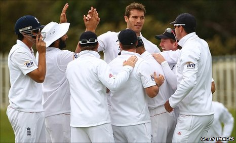 Chris Tremlett (centre) is congratulated
