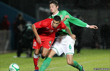 Younes Belhanda of Morocco is challenged by Northern Ireland debutant Adam Barton