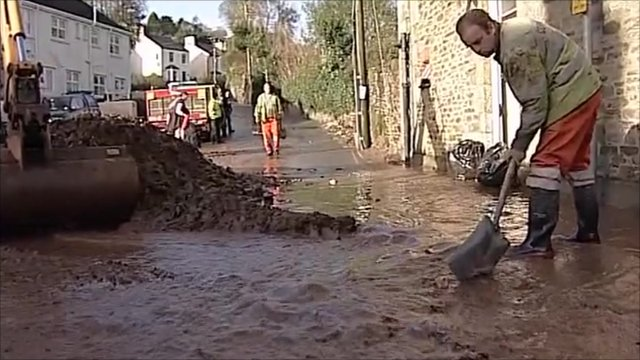 Man clearing mud and water