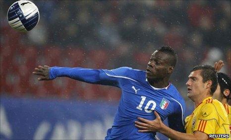 Italy's Mario Balotelli and Romania's Gabriel Tamas