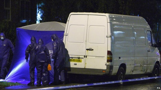 Police investigators with the van in Sunningdale