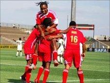 Equatorial Guinea celebrate scoring a goal at the AWC