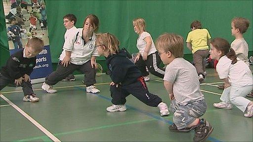 Badminton players limber up