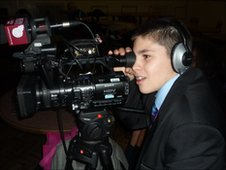School Reporter operates the camera whilst filming dancing