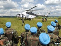 United Nations peacekeepers from India wait to board an helicopter in Muhanga