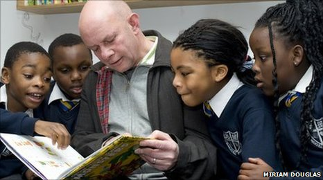 Nick Hornby and children from St Monica's RC Primary School at the launch of the Ministry of Stories literacy project