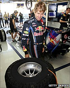 Sebastian Vettel checks out the new Pirelli tyres in the Red Bull garage in Abu Dhabi