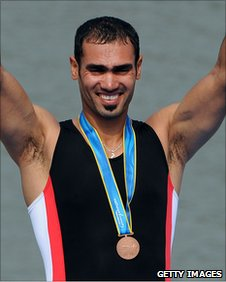 Iraqi rower Haider Rashid celebrates his bronze medal in the single sculls at the Asian Games