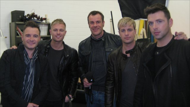 Westlife stars Mark, Shane, Nicky and Kian together with Paul Henley of BBC World Service