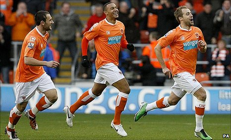 Luke Varney (right) celebrates his goal against Wolves
