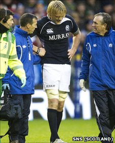 Scott MacLeod hobbles off with a rib injury at Murrayfield