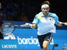 David Ferrer in action against Roger Federer