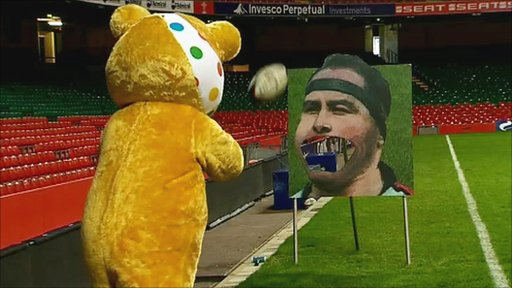 Pudsey Bear tries to hit Brian Moore in the mouth