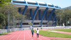 Runners train on the athletics track which adjoins the Maracana stadium