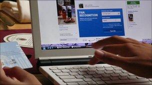 A woman registers as a fan on Facebook