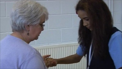 A School Reporter dances with a member of The Walton Clubmoor Community Centre in Liverpool