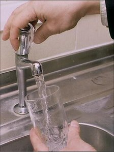 Glass being filled with water from the tap