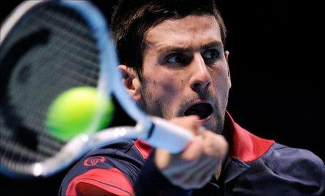 Novak Djokovic plays a forehand against Tomas Berdych