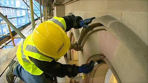 Workman restoring part of a Watson Fothergill building in Nottingham