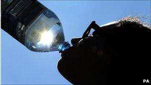 Man drinking bottled water