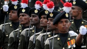 Sri Lankan soldiers march during a military parade in Colombo on 19 November , 2010