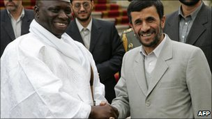Iranian President Mahmud Ahmadinejad (right) shakes hands with the President of Gambia Yahya Jammeh in Tehran, 2 December 2006