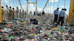 Police search through debris the day after the stampede