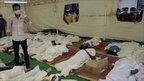 A Cambodian medic checks bodies at Preah Kossamak hospital