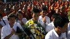 Buddhist monks join mourning ceremony near the bridge