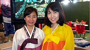 Two female members of the South Korea 2022 delegation in traditional costume