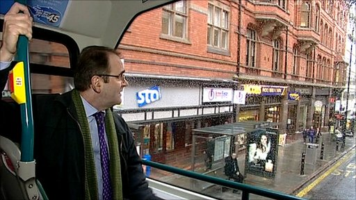 Dominic Heale on a double decker bus in Nottingham city centre