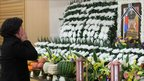 A relative of one of the South Korean soldiers killed by North Korea's attack on Yeonpyeong Island cries in front of a memorial altar at a military hospital
