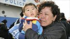 A woman and child arrive with local residents from Yeonpyeong island at the port in Incheon