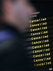 An information board shows cancelled flights at Lisbon's international airport, 24 November