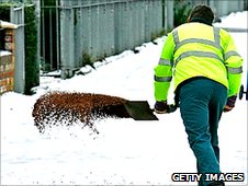 Man gritting pavement