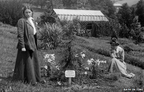 Adela Pankhurst and Annie Kenney beside a cedar tree planted by Emmeline Pankhurst