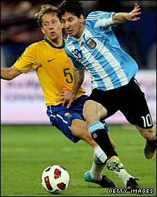 Lionel Messi takes on Brazil