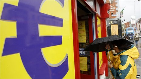 A woman enters a euro discount store in south Dublin, Ireland