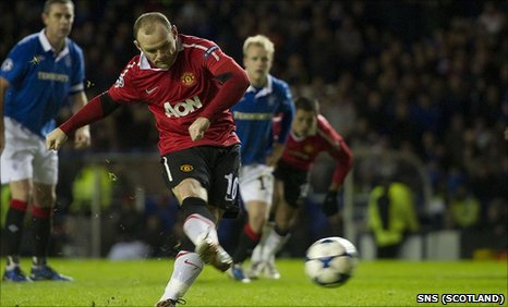 Wayne Rooney tucks away a late penalty at Ibrox