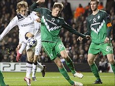 Luka Modric (in white) half-volleys in a shot to put Spurs 2-0 up against Werder Bremen