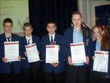 Students from Park High School in Merseyside receive their School Report certificates
