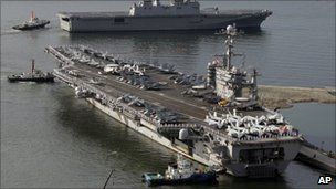File image (from July 2010) of the USS George Washington, bottom, and the South Korean navy&#039;s landing ship Dokdo Ham