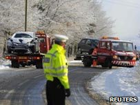 Vehicles are recovered after an accident on a snow covered  road