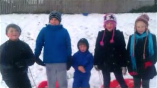 Kids in Whitby, Yorkshire go sledging