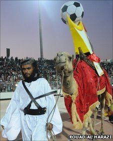 Man with camel at opening Gulf Cup ceremony