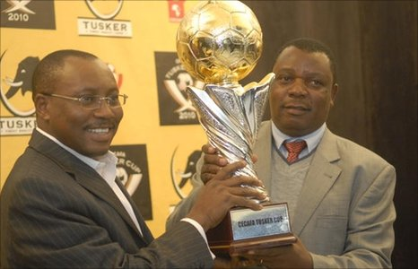 Nicholas Musonye (r) with the Cecafa Challenge Cup trophy