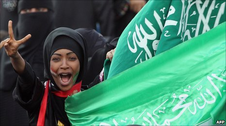 Saudi team supporter with flag