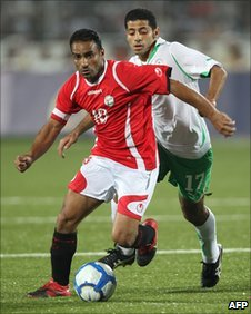 Yemen's Ali Mohammed Nono (10) vies for the ball against Saudi Arabia's Taysir Jaber (17)